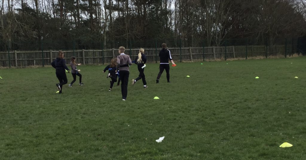 Year 6 students at South Avenue training on the school fields with Newcastle Falcons